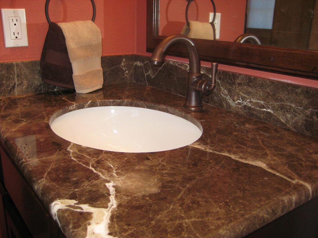 close up of dark emprador marble top