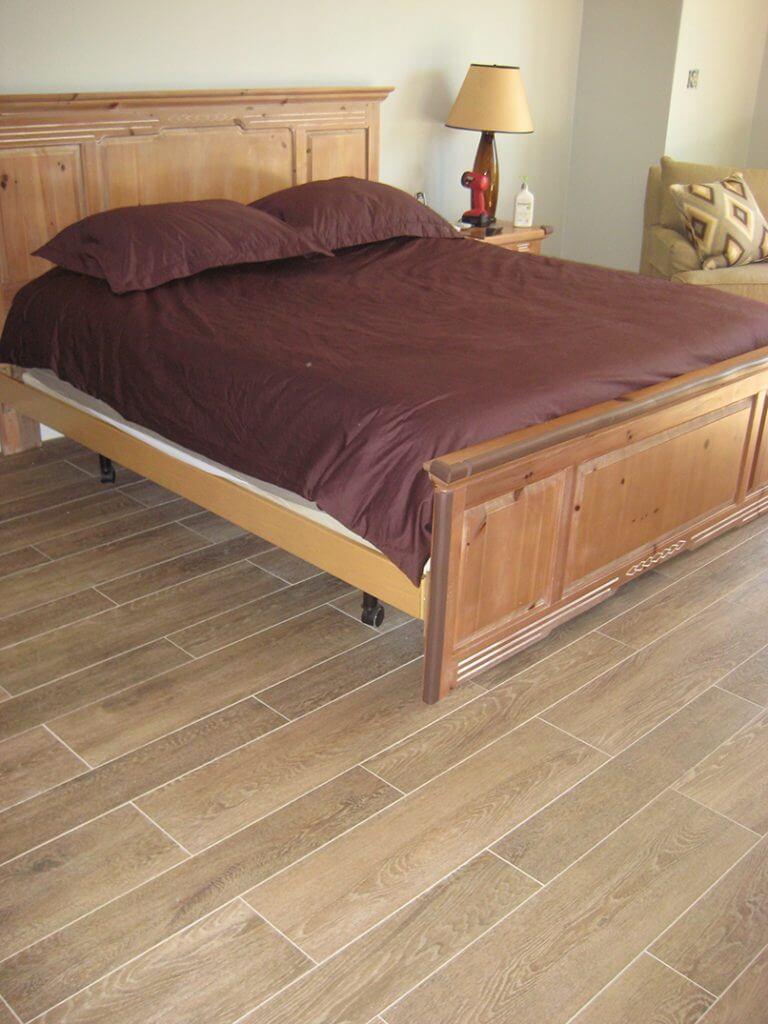 master bedroom in tile that looks like wood 2 widths