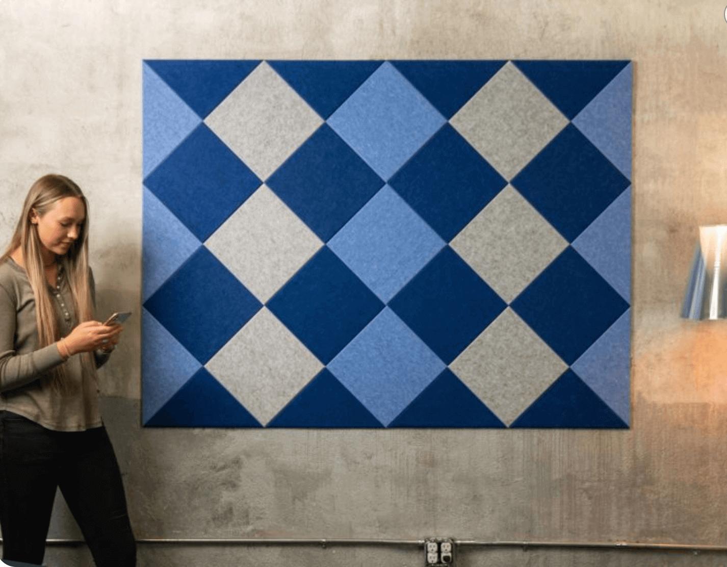 Blue argyle acoustic tile on wall